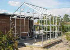 Building our Harbor Freight 10' x 12' Greenhouse: Part Four: Assembling the Roof, Windows, and Doors