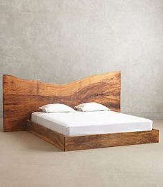 Wood backboards make a simplistic beautiful bed