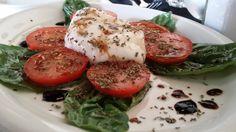 At Tonino, the Burrata Mozzarella, a stuffed mozzarella with tomato and basil, is a must order.