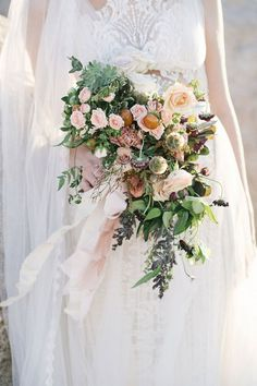We traveled to Joshua Tree National Park to create this bouquet for our client Sydnie's bridal portraits. In the south, it's tradition to have a photo session of the bride in her gown a month before the wedding. Then, it's displayed at the wedding reception for all to see. You'll see ideas for an Organic Bouquet, lush bouquet, wedding ceremony, wedding flowers, floral arrangement and flower crowns |  #wedding #weddingflorals #floral #weddingflowers #organicbouquet #lushbouquet #weddingbouquet