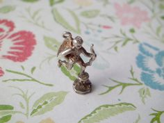 Vintage Silver 3D English Shaftesbury Memorial Fountain Eros Piccadilly Circus Travel Charm by oneofakindwisconsin on Etsy https://www.etsy.com/listing/257054355/vintage-silver-3d-english-shaftesbury