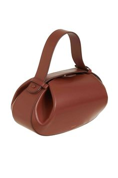 A modern take on the bowling bag, the Loaf is crafted with smooth nappa and features an adjustable top handle and cross-body strap. Big enough for the essentials and features an internal branded… Hobo Purses, Purses And Bags, Fashion Handbags, Fashion Bags, Cow Leather, Leather Bag, Sacs Design, Tan Bag, Large Wallet