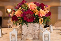 Jamie and Bryan set the perfect scene for their rustic fall wedding–complete with carved pumpkin table numbers, mason jars and mulled apple cider!