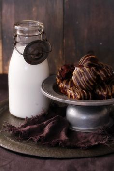 Rolo brownie bites    4 large eggs  1 cup sugar, sifted  1 cup brown sugar, sifted  225g / 8 ounces melted butter  11/4 cups cocoa, sifted  2 teaspoons vanilla  1/2 cup flour, sifted  1/2 teaspoon kosher salt  6 1.7oz Rolo pack of candy