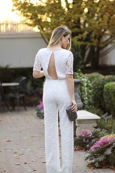 Casandra of Dressed for Dreams is #SoDVF in the Kendra embellished open back jumpsuit and the Powerstone crystal minaudière. Shop the Kendra jumpsuit: http://on.dvf.com/1IRJnuJ  Shop the Powerstone minaudière: http://on.dvf.com/1RC8hpi