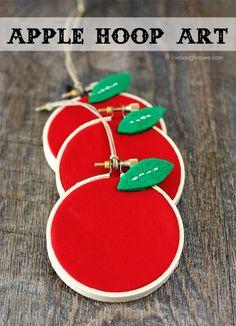 Super fun Back to School Craft!  Perfect for teacher gifts too.  DIY Apple Hoop Art.  Tutorial with livelaughrowe.com #backtoschool #apple #hoopart