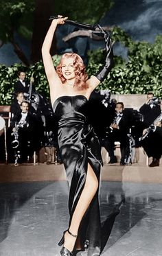"""Rita Hayworth in """"Gilda,"""" 1946   When """"Gilda"""" premiered at the first ever Cannes film festival, everyone was buzzing about Hayworth's striptease to """"Put The Blame On Mame"""" wearing a strapless, black satin sheath dress with a long side slit and extra long gloves. Costume designer Jean Louis created the custom gown (which required a corset and custom harness) and helped cement the concept of a femme fatale."""
