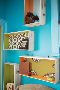 Drawer Decor. Dresser drawers painted a contrasting color and backed with fabric or mirrors provide a funky place for collectibles. What a conversation piece huh?