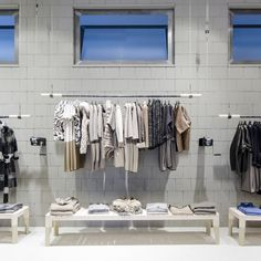 Fashion store by Studio Isacco Brioschi Bergamo Italy 15 Fashion store by Studio Isacco Brioschi, Bergamo Italy...colour coded storage and display for my warehouse wardrobe!