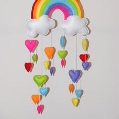 This is variation of the rainbow and cloud mobiles, it has hearts instead of raindrops.  It is 3 separate mobiles giving you the option to hang them at all different lengths.    If you would like just 1 of these mobile please email or convo me for a price.   This mobile is a made-to-order. SIZE: *~*~*  The rainbow has selection of 2 different size hearts ( 6 hearts approx 8cm (3) each and 14 hearts approx 6cm (2.5) each ).  The clouds have a total of 10 hearts on each ( 5 hearts appprox 8cm…