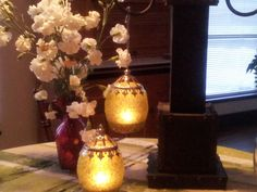 Ambiance created by these Citron Filigree Candle Lanterns.
