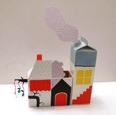Häuser aus leeren Getränke-Kartons