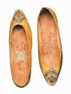 Abigail Adams' Regency era slippers, from The Smithsonian, made of yellow kid, embroidered on the toe.