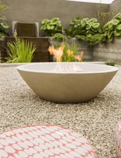 Laidlaw Schultz architects 6. Add warmth When it's outdoor film night, there's often a chill in the air after dark, even during summer. The modern ethanol fire pit, also referred to as bio-fuel, is easy to use – no wood is required and it's virtually odourless. This keeps the neighbours happy, and the wide range on the market means there's a product to suit your style.