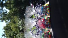 Monster Truck Party Favors! Dollar Store Trucks, plain M & M's, cello bags and ribbon that resembles checkered flags!