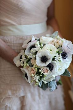 A bouquet with garden roses, ranunculus, and dusty miller | Brides.com