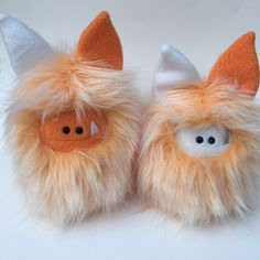 Not quite identical twins but they sure are cute!  These Fuzzlings are ready for adoption! Fuzzling: Handmade plush monster