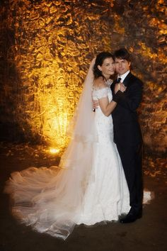 Kate Holmes in an off-the-shoulder lace Armani wedding dress with long veil