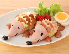 Hedgehog sandwich. It's just the picture, but it looks like you just put three slices on the top of a bun and slide in some cheese for the spikes, cut sausage for the feet, and roll a piece of ham up for the face