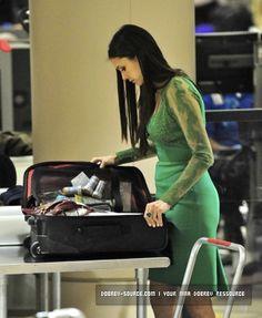 inside nina dobrev's luggage