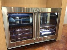 All new KitchenAid under counter refrigerator and beverage center.