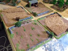 Fields made form door mat, corrugated cardboard and extra details such as a barn from Hovells and some 4ground carts. Created by Rich Goss