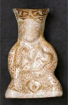 Hollow Vessel in the Shape of a Woman Holding a Child Object Name: Figural vessel Date: century Geography: Iran Culture: Islamic Medium: Stonepaste; molded, luster-painted on an opaque white glaze Ceramic Pottery, Pottery Art, Cradle Of Civilization, Persian Culture, Mother Goddess, Iranian Art, Mother And Child, Islamic Art, Art
