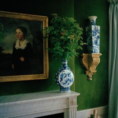Green velvet walls, blue and white porcelain, painting with gold frame - from the home of Tory Burch