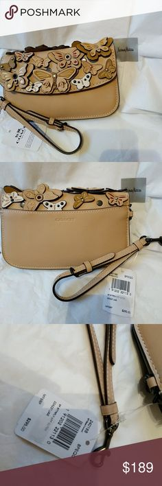 Coach 1941 Beachwood Butterfly Clutch Wristlet New with tags, has butterflies on the outside and a zip pocket inside. Can be used as a clutch or wristlet (detachable wristlet strap). Bought from Neiman Marcus, MFSRP $295 Coach Bags Clutches & Wristlets