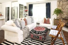 LOVE white slipcovered sofa.... wonder if this would work in my kitchen with this rug....hmmmm