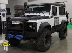 Mad kitted Defender 90 with a tough exterior coating of Line-X.