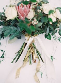 Bridal bouquet with #protea | Photography: Laura Leslie Photography - www.lauralesliephotography.com Photography: Gracie Blue Photography - www.grblue.com Read More: http://www.stylemepretty.com/2014/04/24/enchanted-winter-wedding-inspiration/ #farmwedding #bouquet