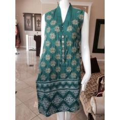 Gorgeous Green Silk shirt for sale at www.jiya-designs.com wear it with tights or cigarette pants and look trendy