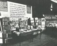 """1926: For its 50th anniversary, ALA encourages every library in the US to set up an exhibit to let the public know about the interesting things that libraries do. This library exhibit is at a farmers' meeting in New Jersey. The ALA Bulletin notes: """"Probably everyone who passed these exhibits stopped at least to read the captions."""" American Library Association, 50th Anniversary, New Jersey, Exhibit, Libraries, Farmers, Captions, This Is Us, At Least"""