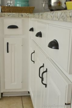 Great kitchen makeover at The Frugal Homemaker with matching hardware!