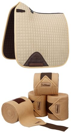 A stunning horse gift set combining the luxurious LeMieux ProSport Suede Dressage Square (D-Ring) in the fabulous beige colour way and the coordinating set of four beige LeMieux luxury fleece/ polo bandages.  Size of saddlecloth is large/ full and bandages are one size. This beige colour way features stunning brown detailing for sophisticated style