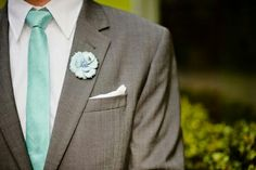Charcoal Grey suit and Tiffany Blue ties....maybe the hubby can be different and have a bow tie :)