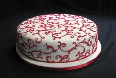 1 tier mehndi ceremony wedding cake, white with red detail