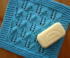 Leaf pattern knit washcloth. I used a needle two sizes bigger than pattern says so that wash rag would be larger. I really like the looseness this change made. The pattern was a little off on the second half, creating more stitches with each row.