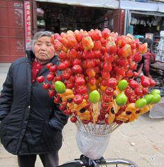 Delicious glazed strawberries in a street market!   Xizhou town, Dali, China