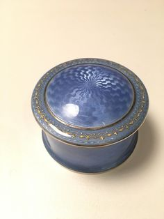 Gustav Gaudernack design for David Andersen. Guilloché silver bonboniére with translucent light blue enamel  and inlaid gold pattern. 1905-1910