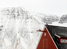red on white majestic mountains and red A frame roof