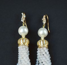 ⚜️Long and playful tassel earrings with Natural White Agate tassels and Natural Big Pearls. High quality Cubic Zirconia CZ 16K Gold Plated over Brass Ear hook and Cubic Zirconia Micro Pave Crown.  ⚜️Versatile, light weight and right on trend!  ⚜️Total length including wires is 5.1 inches (13 sm)  Wear this breathtaking earrings with the matching necklace and bracelet for maximum effect.  https://www.etsy.com/listing/504426391/luxury-gemstone-necklace-agate-rock?ref&#x...