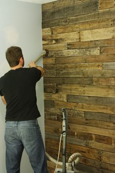 "DIY: Accent wall out of wood pallets. 1st hang Plywood.  Find untreated wooden pallets (2 doz).  Cut through nails & disassemble.  Sand splinters and dirt.  Clean. Sort by width, then condition. Use 1"" nails & nail gun.  Will need saw for cut arounds.  Once done, vacuum and apply atan polyurethane."