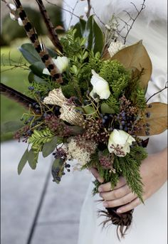 beautiful seasonal bouquet with pheasant feathers