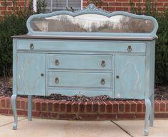pale blue mirrored back buffet
