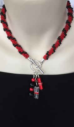 Playful red and black beaded kumihimo necklace! N.stapleydesigns@gmail.com Also on facebook