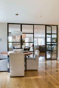 interior by choc studio - modern residence. #pure-choc #foscarini # round_table #interior_design #steel_doors - photography by Denise Keus
