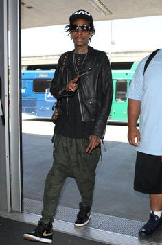 "Wiz Khalifa Spotted in the Air Jordan 1 ""Black & Metallic Gold"""