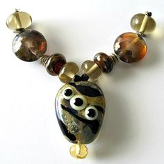 Lampwork Eye Pendant Bead-Focal by PacificJewelryDesign on Etsy (Craft Supplies & Tools, Jewelry & Beading Supplies, Beads, lampwork, eye pendant, lentils, rondelles, earthtones, iridescent, brown, black, white, blue, amber, gold)